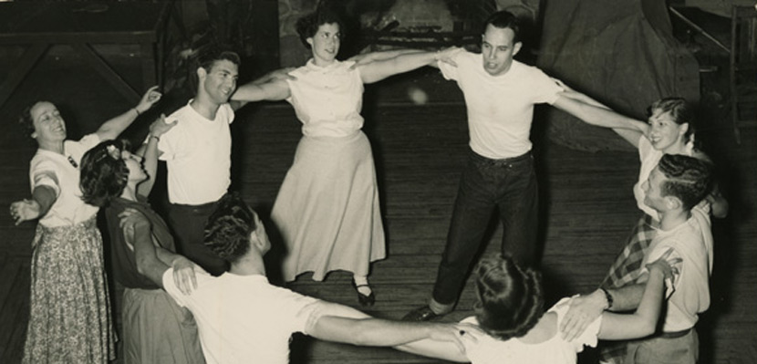 Young Jewish men and women dance in a circle, circa 1950. From the digital collection of the Center for Jewish History.