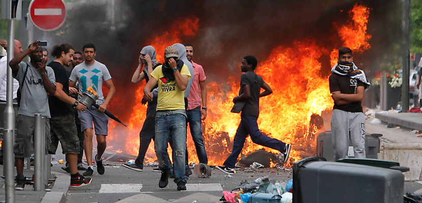 Rioters, some of whom burned several Jewish-owned stores, face police in a Paris suburb on July 20, 2014. AP Photo/Thibault Camus