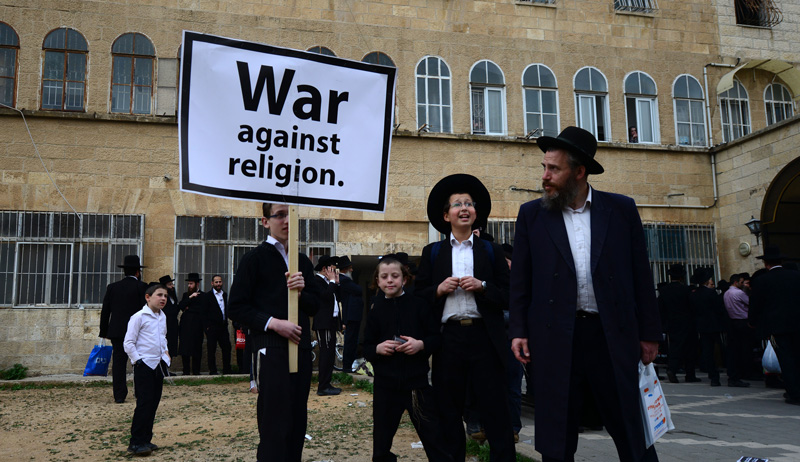 Haredi Jews protest a military draft bill on March 2, 2014 in Jerusalem. Photo by Salih Zeki Fazlioglu/Anadolu Agency/Getty Images.