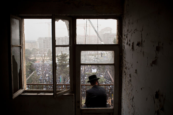 A haredi man looking over a demonstration in Israel. AP.