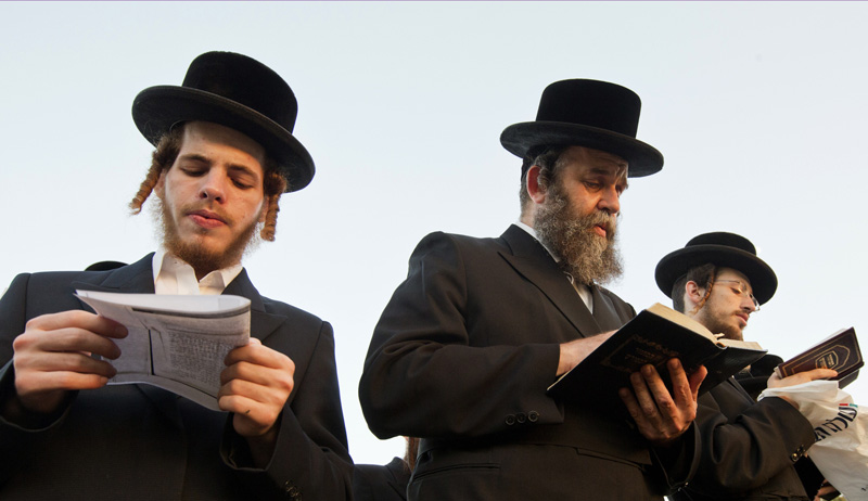 Ultra-Orthodox men praying in Ramat Gan, Israel. Photo by Ahikam Seri/Bloomberg via Getty Images.