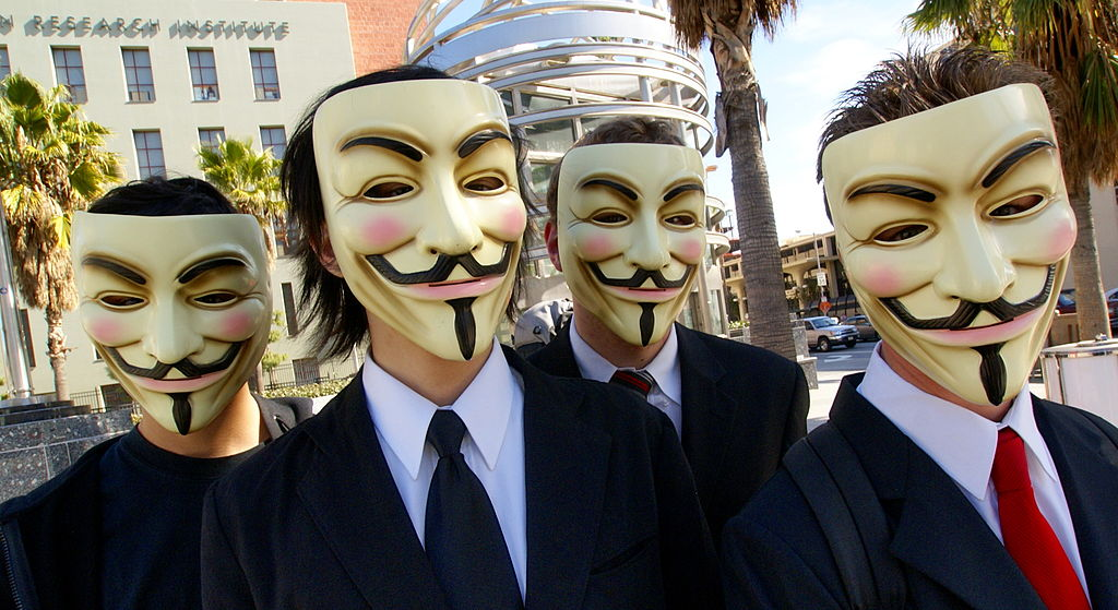 Members of Anonymous, the internet hacking collective. Wikipedia.