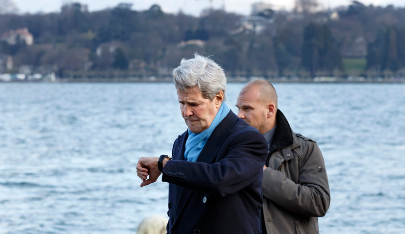 U.S. Secretary of State John Kerry checks his watch as he walks to a meeting with Iranian Foreign Minister Mohammad Javad Zarif in Geneva, Switzerland, Sunday, Feb.  22, 2015. AP Photo/Keystone,Salvatore Di Nolfi.