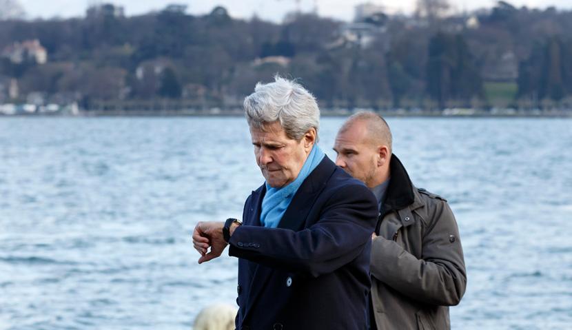 U.S. Secretary of State John Kerry checks his watch as he walks to a meeting with Iranian Foreign Minister Mohammad Javad Zarif in Geneva, Switzerland, Sunday, Feb.  22, 2015. AP Photo/Keystone,Salvatore Di Nolfi.