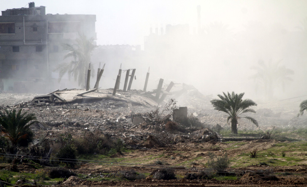 Smoke rises after Egyptian forces, in response to militant attacks, blow up a house in the border town of Rafah in November 2014.