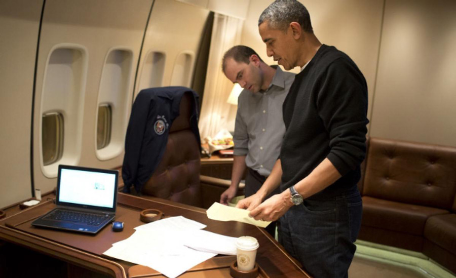 Deputy National Security Advisor Ben Rhodes and President Barack Obama edit a speech on Air Force One in 2013. Official White House photo by Pete Souza.