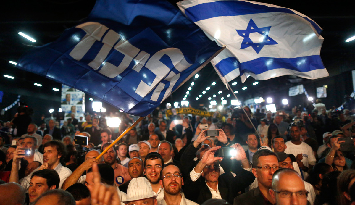 Israelis at an election rally in Tel Aviv in 2015. ABIR SULTAN/epa/Corbis.