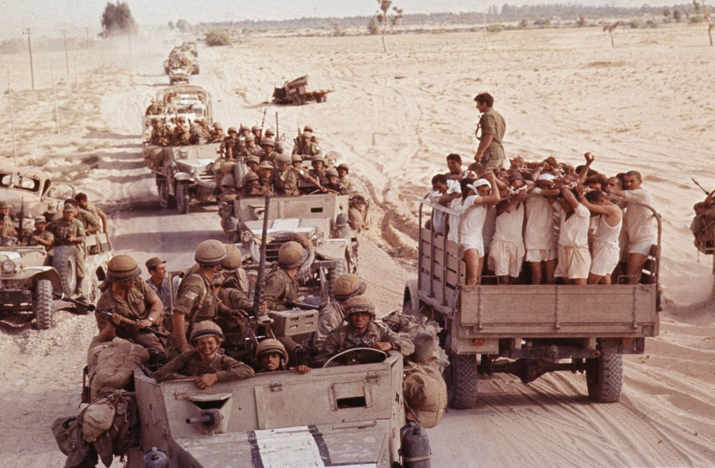 <em>Captured Egyptian soldiers are transported by an Israeli armored convoy to a prisoner of war camp in 1967.</em> Rolls Press/Popperfoto/Getty Images.
