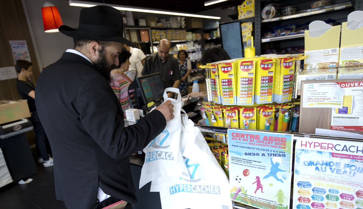 A man waits in line at a Hypercacher kosher supermarket in Paris on June 26, 2015, six months after the jihadist attack in January. Kenzo Tribouillard/AFP/Getty Images.