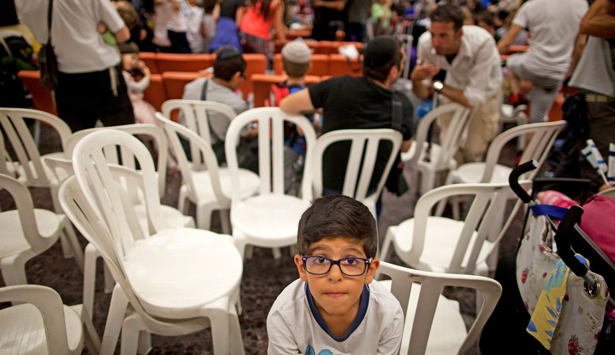 A boy during a welcoming ceremony at Ben Gurion airport in Tel Aviv after arriving on a flight from France on July 16, 2014. Photo by Lior Mizrahi/Getty Images.