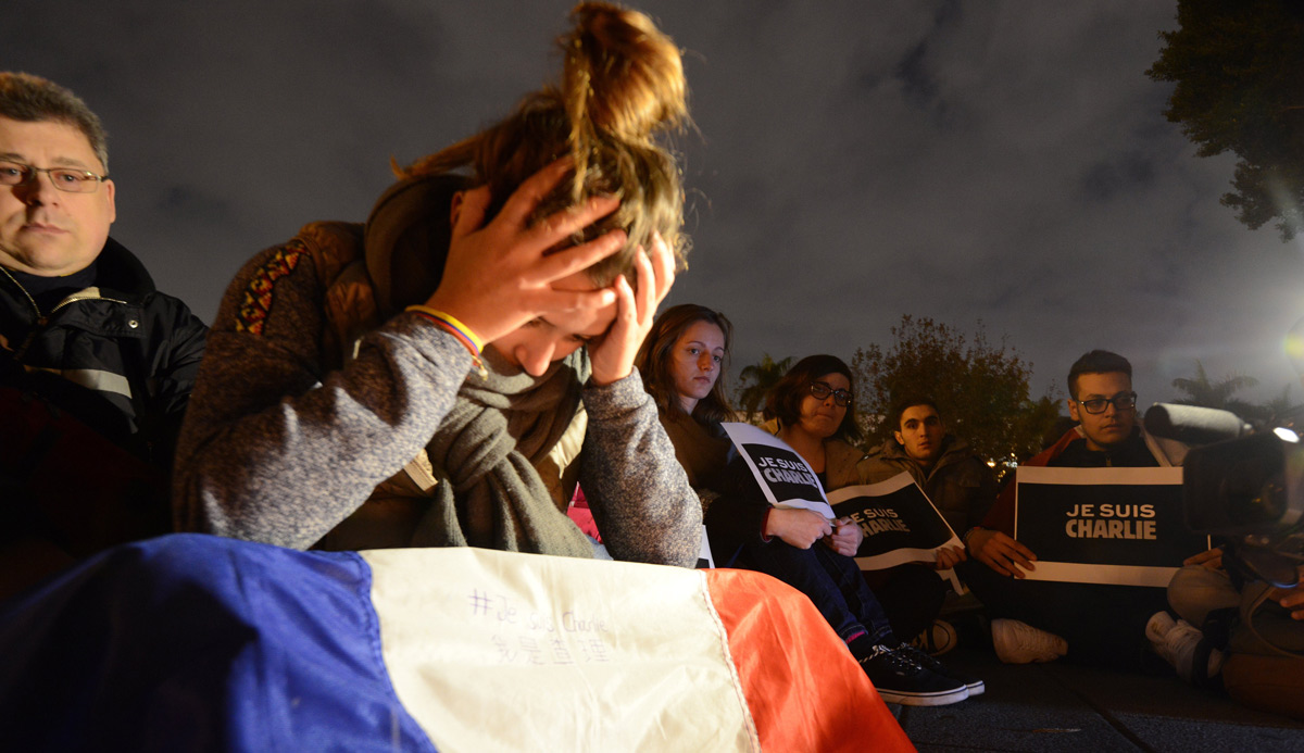 A vigil in solidarity with the victims of the Charlie Hebdo shooting in January 2015. SAM YEH/AFP/Getty Images.