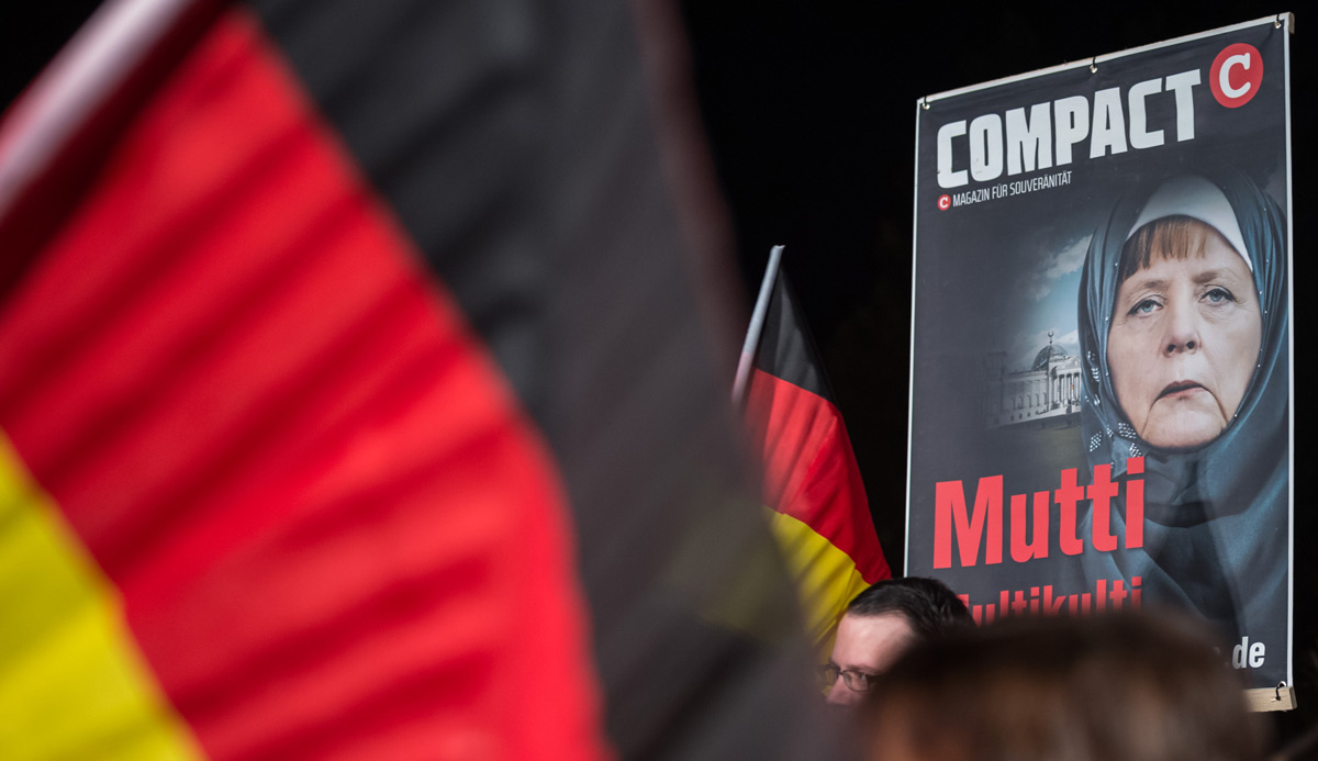 A poster of German Chancellor Angela Merkel at a rally on November 4, 2015 in Erfurt, Germany. Jens Schlueter/Getty Images.