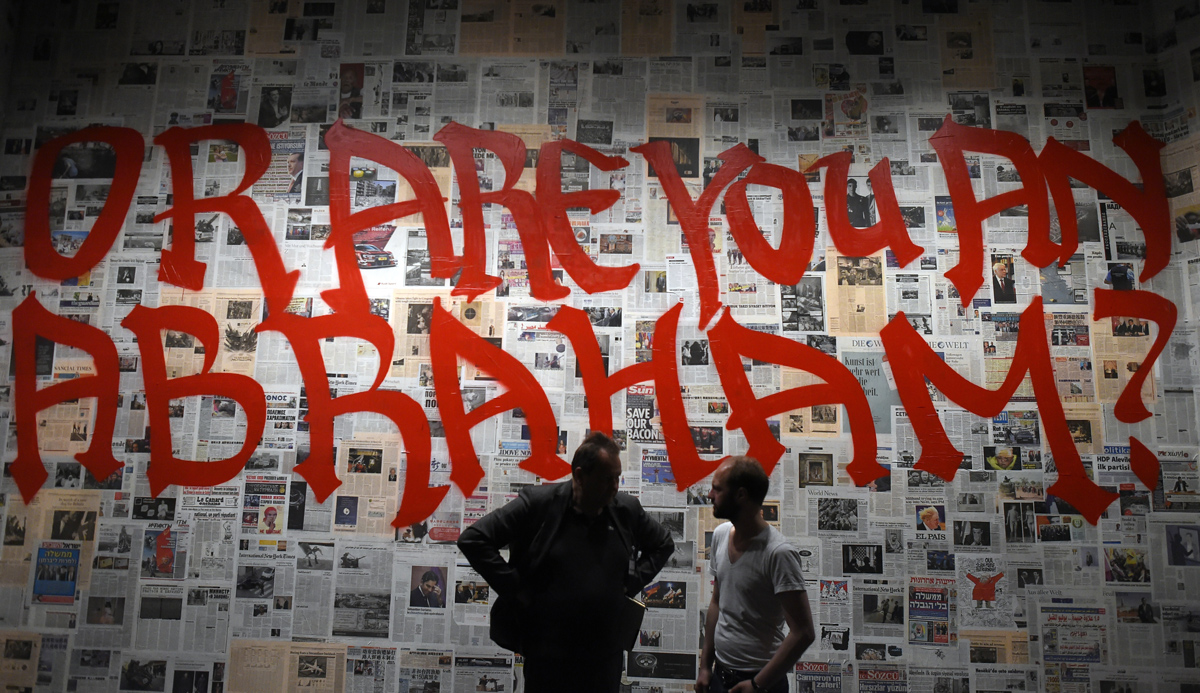 Visitors to theexhibition Obedience: An Art Installation in 15 Rooms by multimedia artist Saskia Boddeke & British film director Peter Greenaway at the Jewish Museum in Berlin. TOBIAS SCHWARZ/AFP/Getty Images.