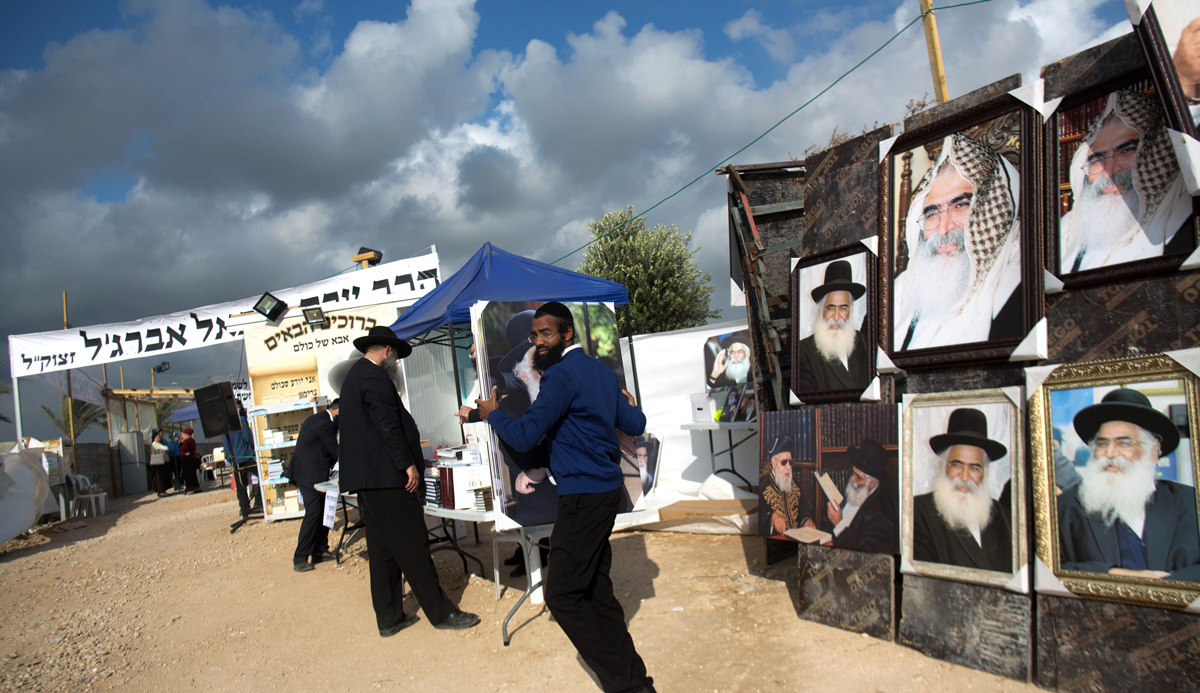 MoroccanJewish men at the tomb of Rabbi Israel Abuhaṣeira, known as the Baba Sali, during the annual pilgrimage to his grave in the southern Israeli town of Netivot, on January 14, 2016. MENAHEM KAHANA/AFP/Getty Images.
