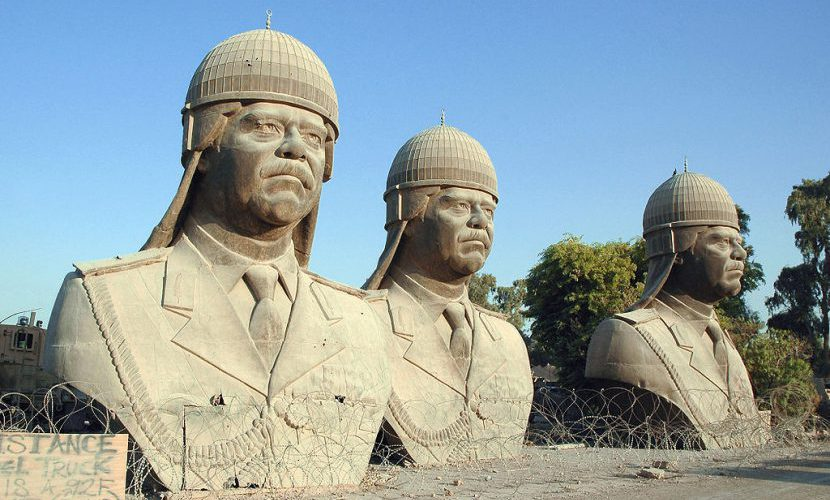 Thirty-foot-tall bronze sculptures of Saddam Hussein, which once sat atop the towers in his palace, 2005. Jim Gordon/U.S. Department of Defense.