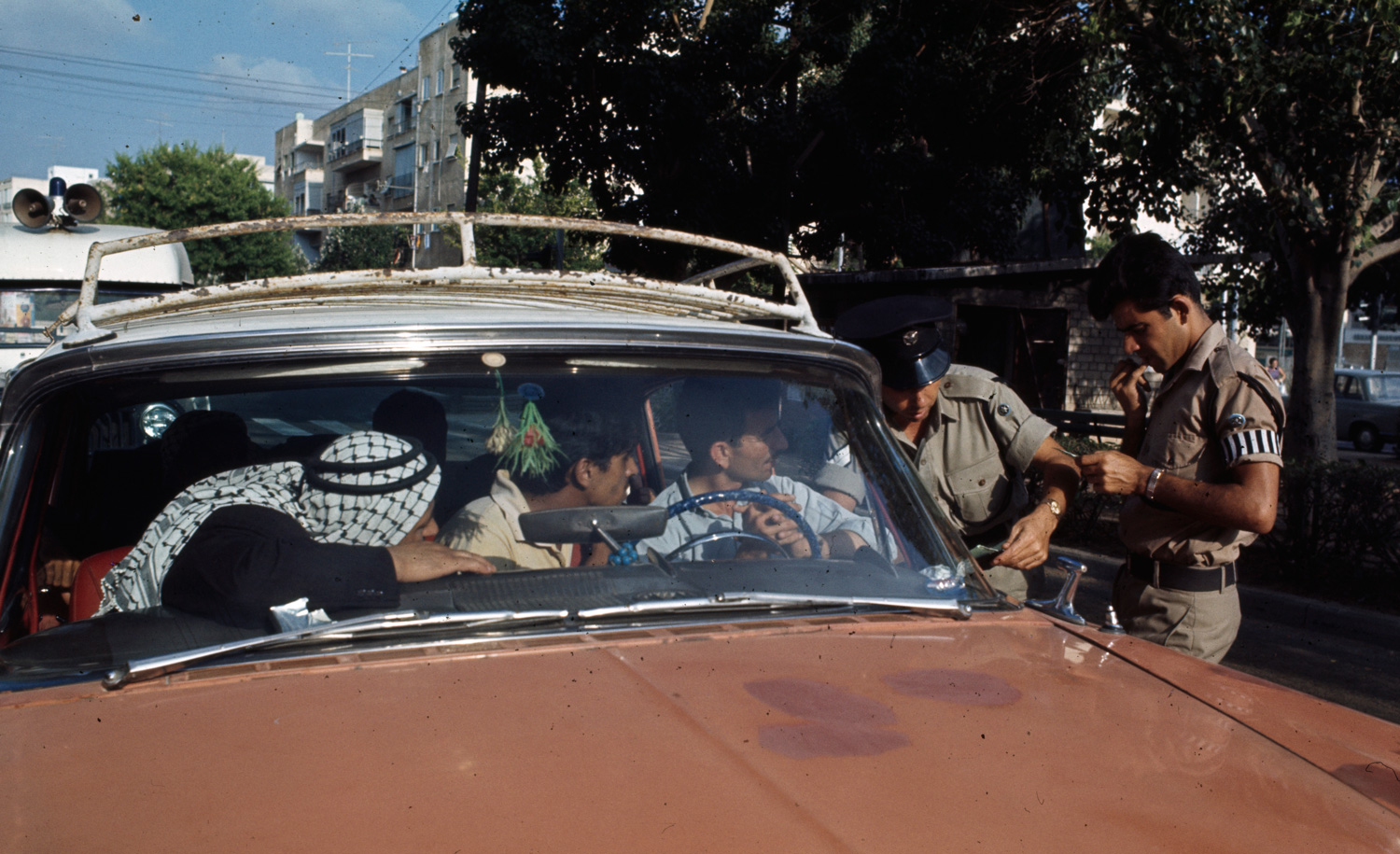 Palestinians in a car checked by Israeli soldiers in July 1967. Manuel Litran/Paris Match via Getty Images.