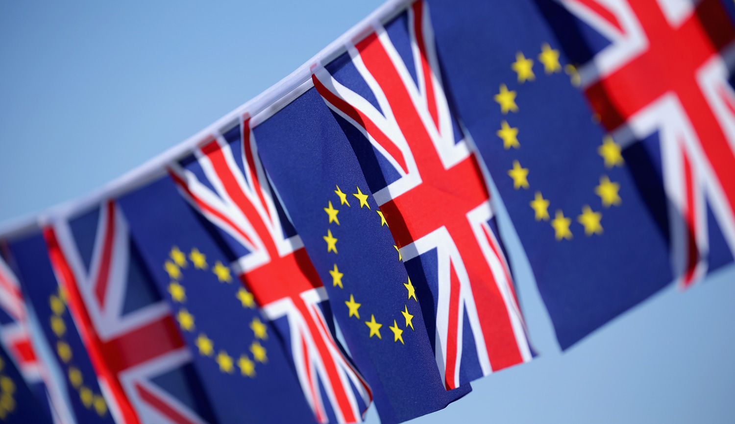 The flags of the European Union and the United Kingdom. Christopher Furlong/Getty Images.
