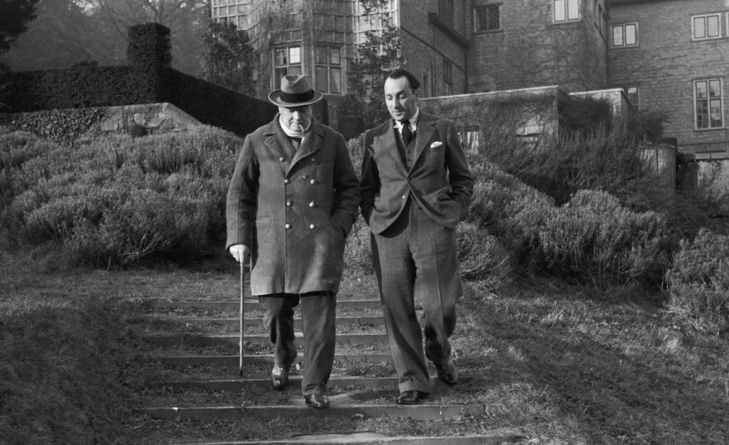 Winston Churchill at his country home in Kent with Picture Posteditor Stefan Lorant on February 25, 1939. Kurt Hutton/Picture Post/Hulton Archive/Getty Images.
