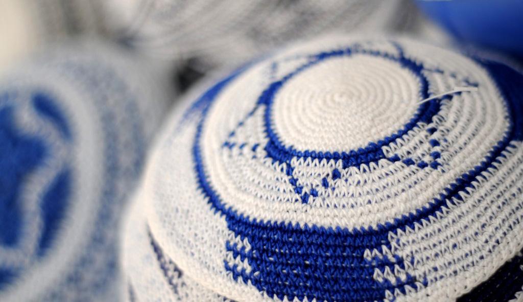Knitted kippot atthe Mahane Yehuda Market in Jerusalem.Sophie Gordon / Flash90.