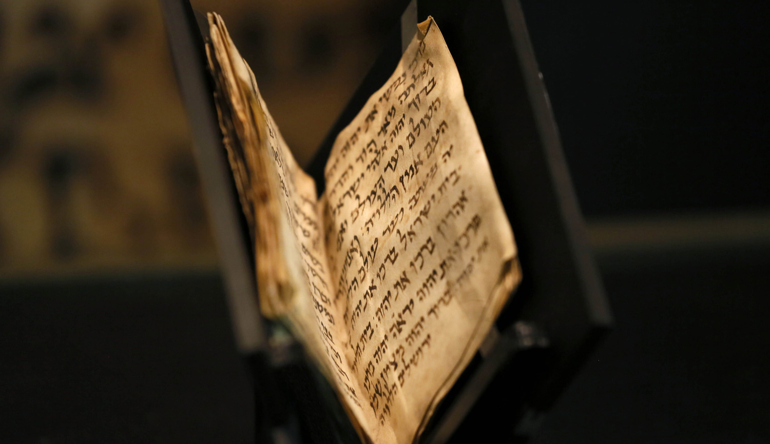 A 1,200-year-old siddur, the oldest known copy in existence, is displayed at the Bible Lands Museum in Jerusalem. GALI TIBBON/AFP/Getty Images.