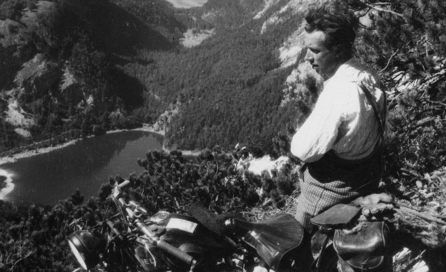 A resting motorcyclist above the three Lakes Gosauer in Austria around 1935. Imagno/Getty Images.