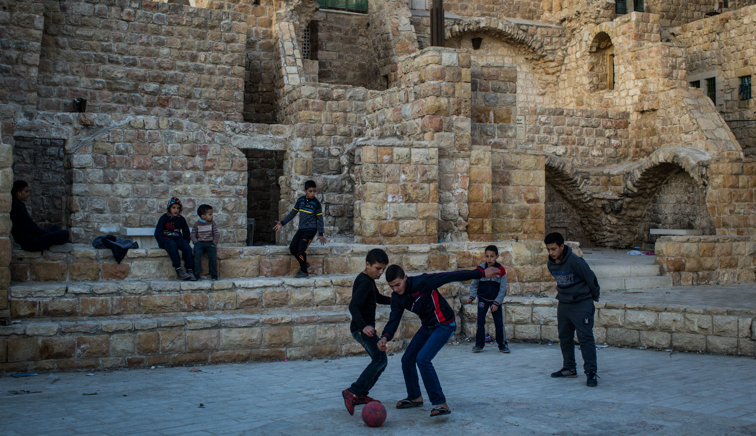 Palestinian boys playing soccer in the West Bank city of Hebron. Chris McGrath/Getty Images.