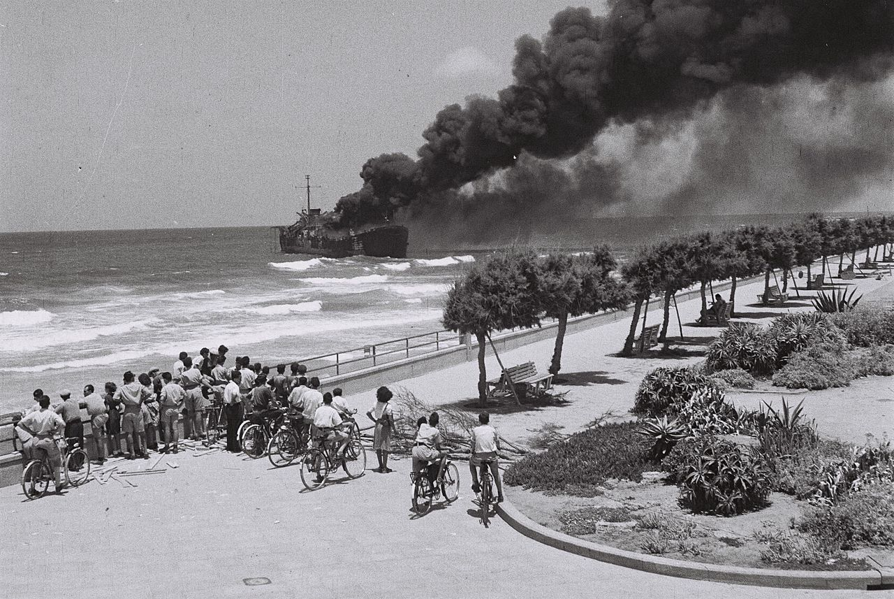 The Altalena on fire after being shelled near Tel Aviv in June 1948. Wikipedia.
