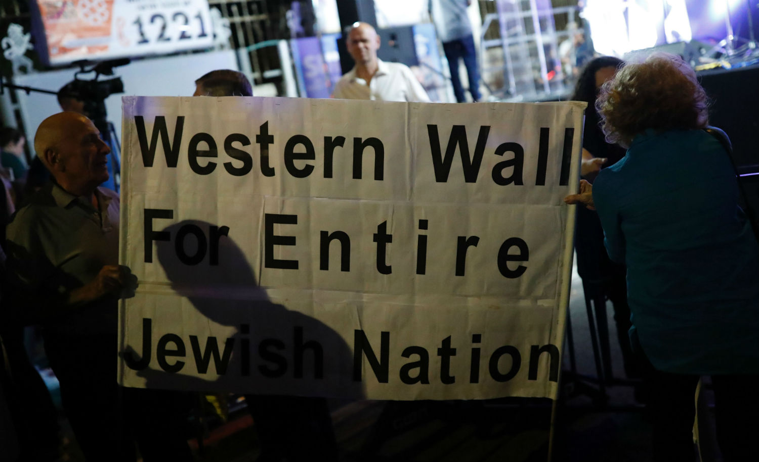 Israelis gather outside prime minister Benjamin Netanyahu's residence in Jerusalem on July 1, 2017, to demonstrate against a government decision to abandon a deal to allow women and men to pray together at the Western Wall. THOMAS COEX/AFP/Getty Images.