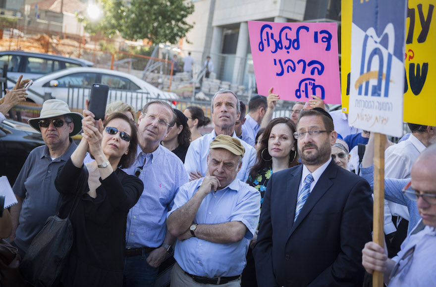 Jewish Agency Chairman Natan Sharansky, center, in brown cap, and Knesset member Dov Lipman, in jacket and tie at right, at a protest held by American and Israeli Orthodox and Conservative Jews outside the Chief Rabbinate offices in Jerusalem, July 6, 2016. Hadas Parush/Flash90.