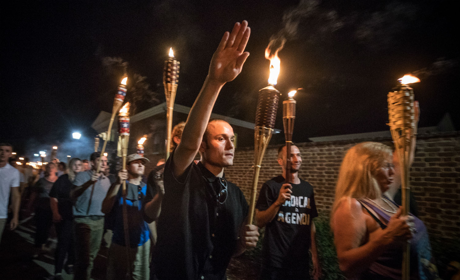 "Chanting ""white lives matter"" and ""Jews will not replace us,"" several hundred neo-Nazis and white supremacists carrying torches march in a parade through Charlottesville, Virginia on Friday, August 11. Evelyn Hockstein/Washington Post via Getty Images."