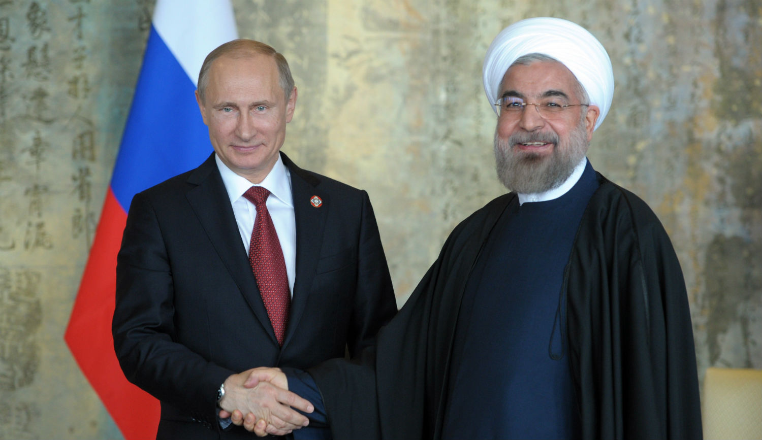 Russian president Vladimir Putin with Iranian president Hassan Rouhani in Shanghai on May 21, 2014. ALEXEY DRUZHININ/AFP/Getty Images.