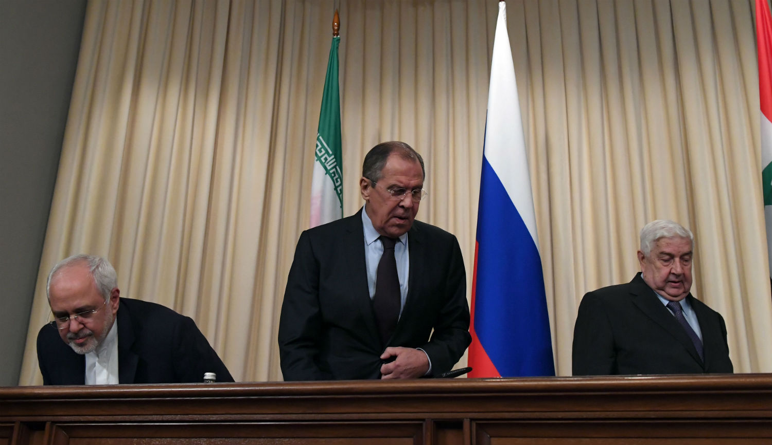 Foreign ministers Mohammad Javad Zarif of Iran, Sergei Lavrov of Russia, and Walid Muallem of Syria at a joint press conference in Moscow on October 28, 2016. KIRILL KUDRYAVTSEV/AFP/Getty Images.