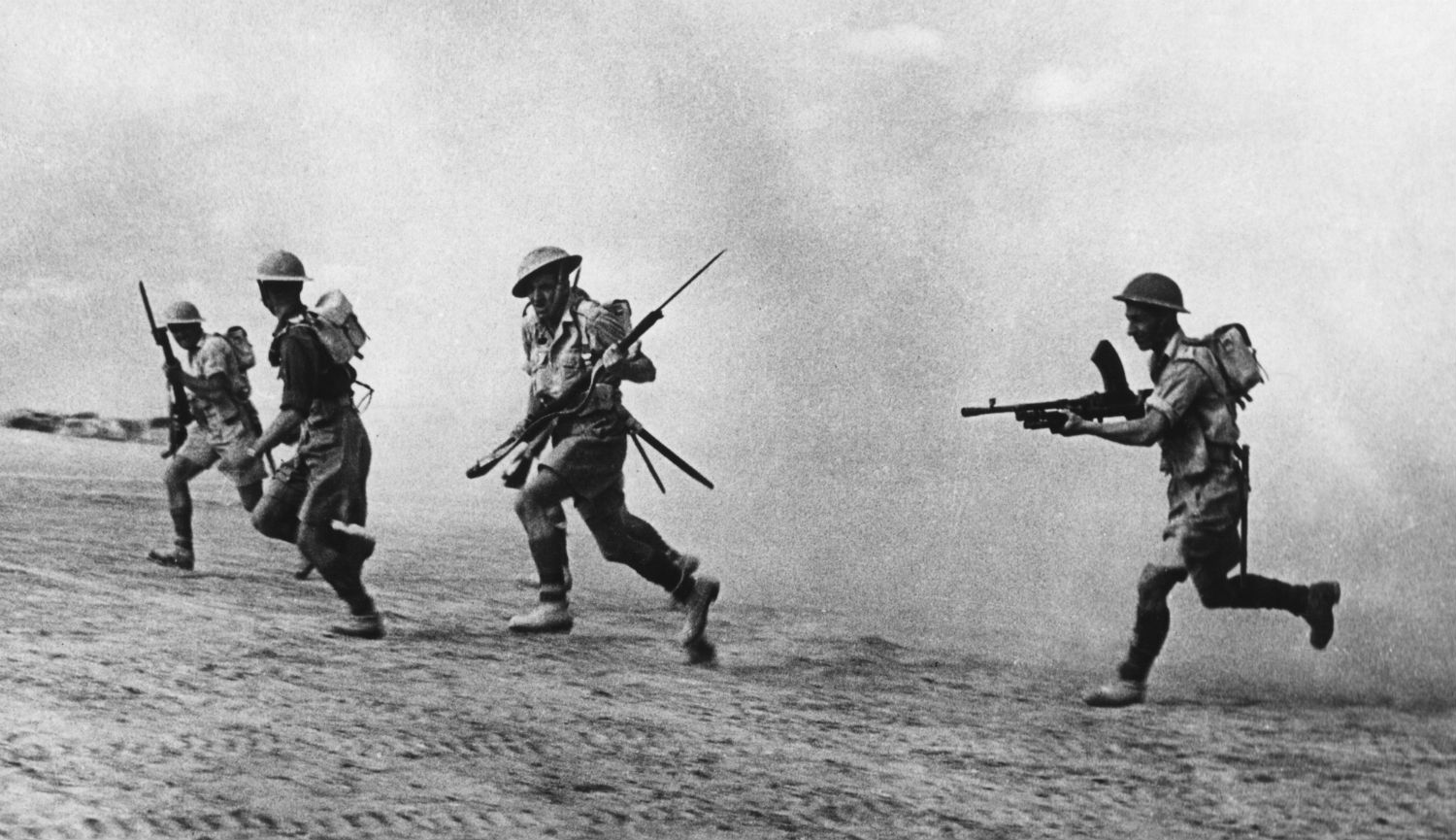 A British infantry patrol following retreating German forces at El Alamein, Egypt in November 1942. Mondadori Portfolio via Getty Images.