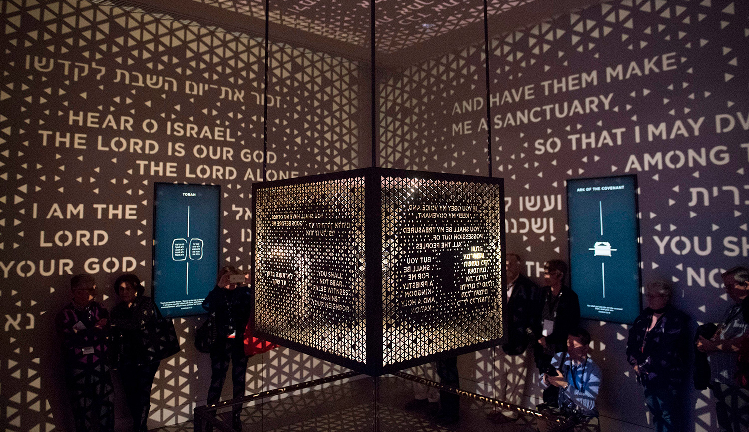 Visitors walk through the Ark of the Covenant exhibit at the new Museum of the Bible in Washington, D.C. SAUL LOEB/AFP/Getty Images.