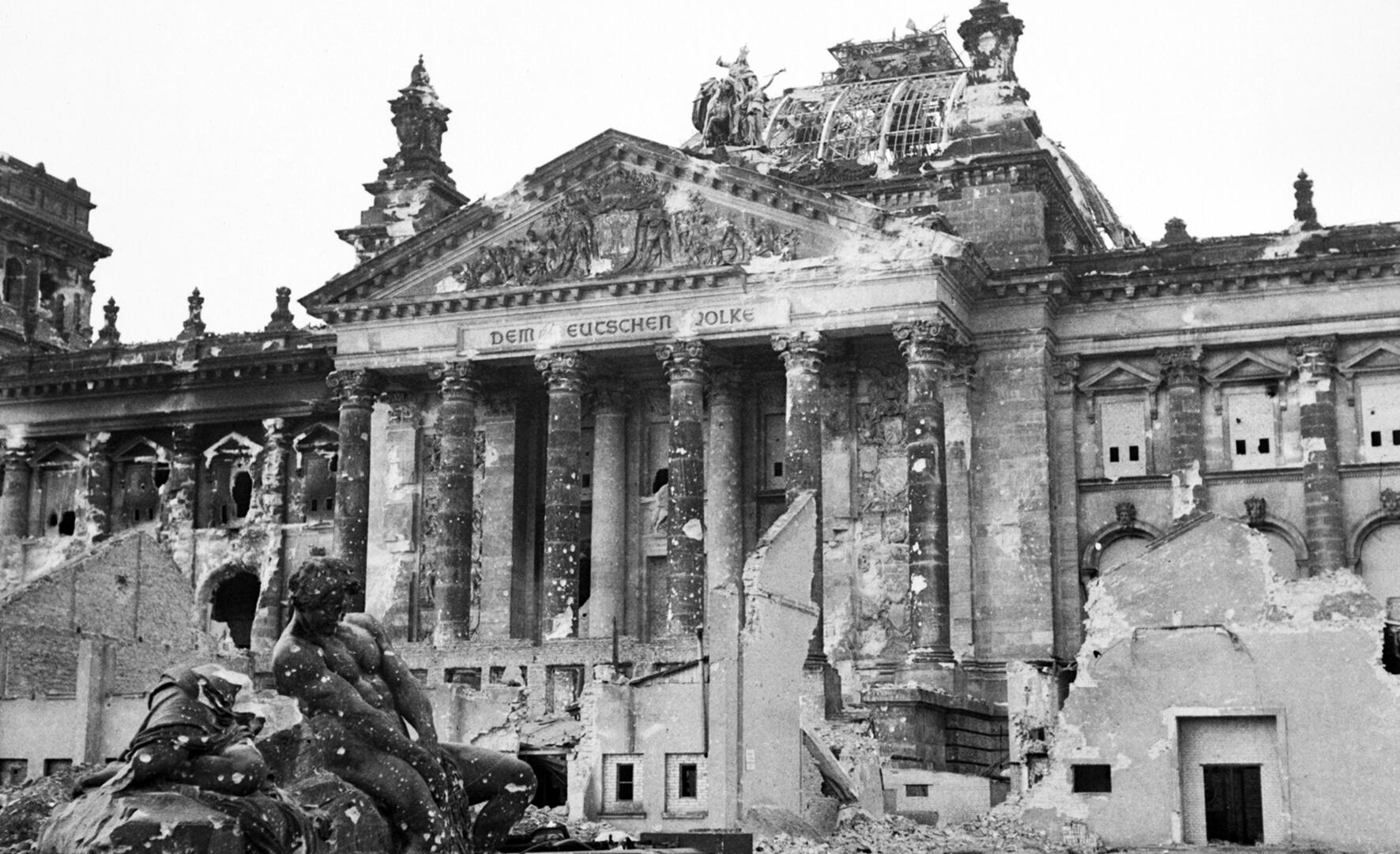 The Reichstag after the bombing of Berlin, June 1945. Wikipedia.