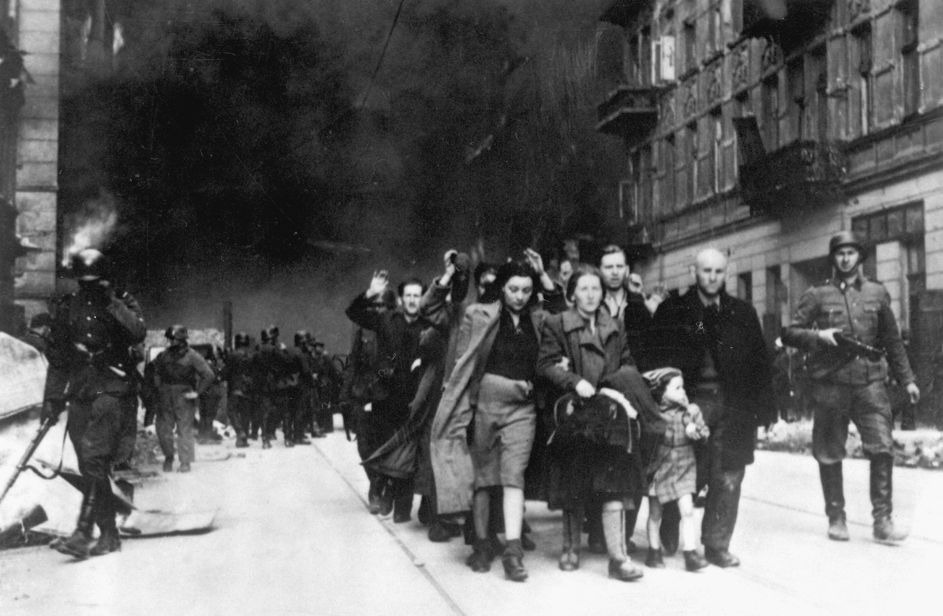 Jews in the Warsaw Ghetto are lead to a deportation point sometime between April 19 and May 16, 1943. Wikipedia.