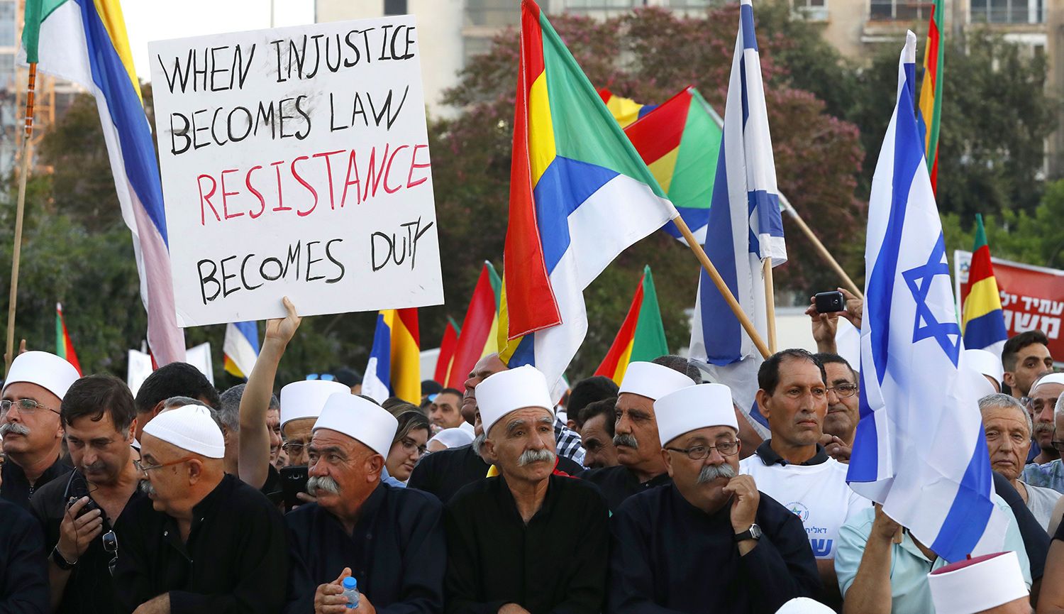 Members of the Israeli Druze community and their supporters protest against the new nation-state law in Tel Aviv. JACK GUEZ/AFP/Getty Images.