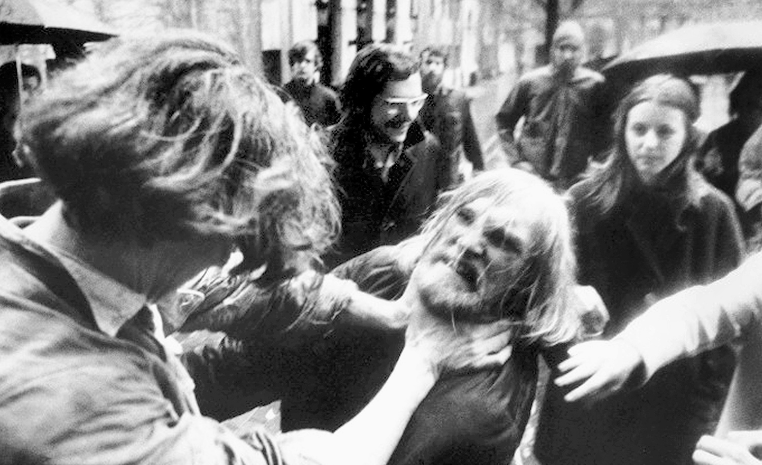 A Columbia University student responds violently to a campus strike in  protest of the Vietnam war that has blocked his way to class. Mel Finkelstein/NY Daily News Archive via Getty Images.