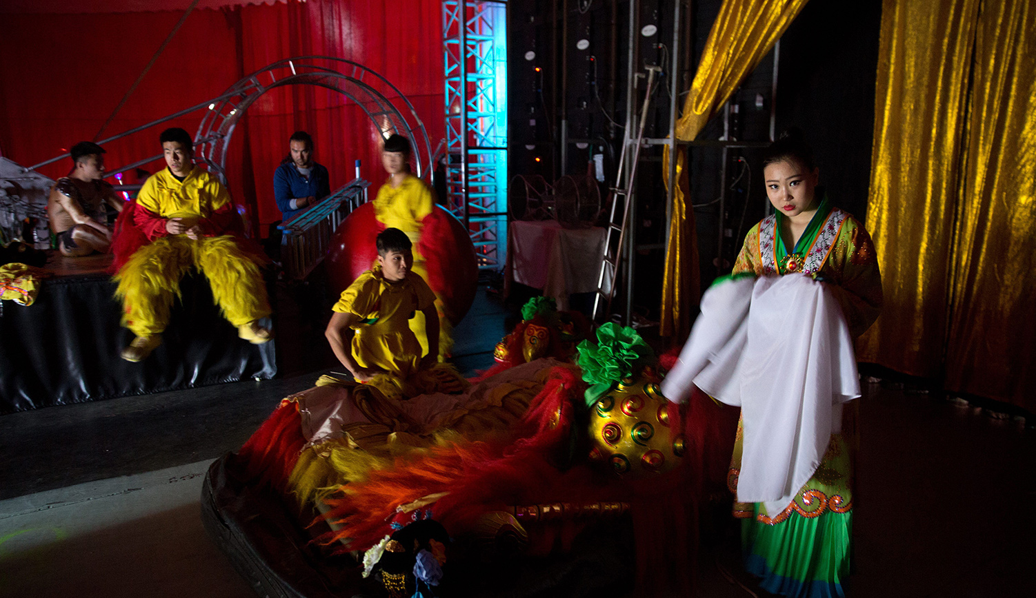 Chinese circus acrobats wait backstage prior to their performance in the Israeli city of Haifa on March 29, 2016. MENAHEM KAHANA/AFP/Getty Images.