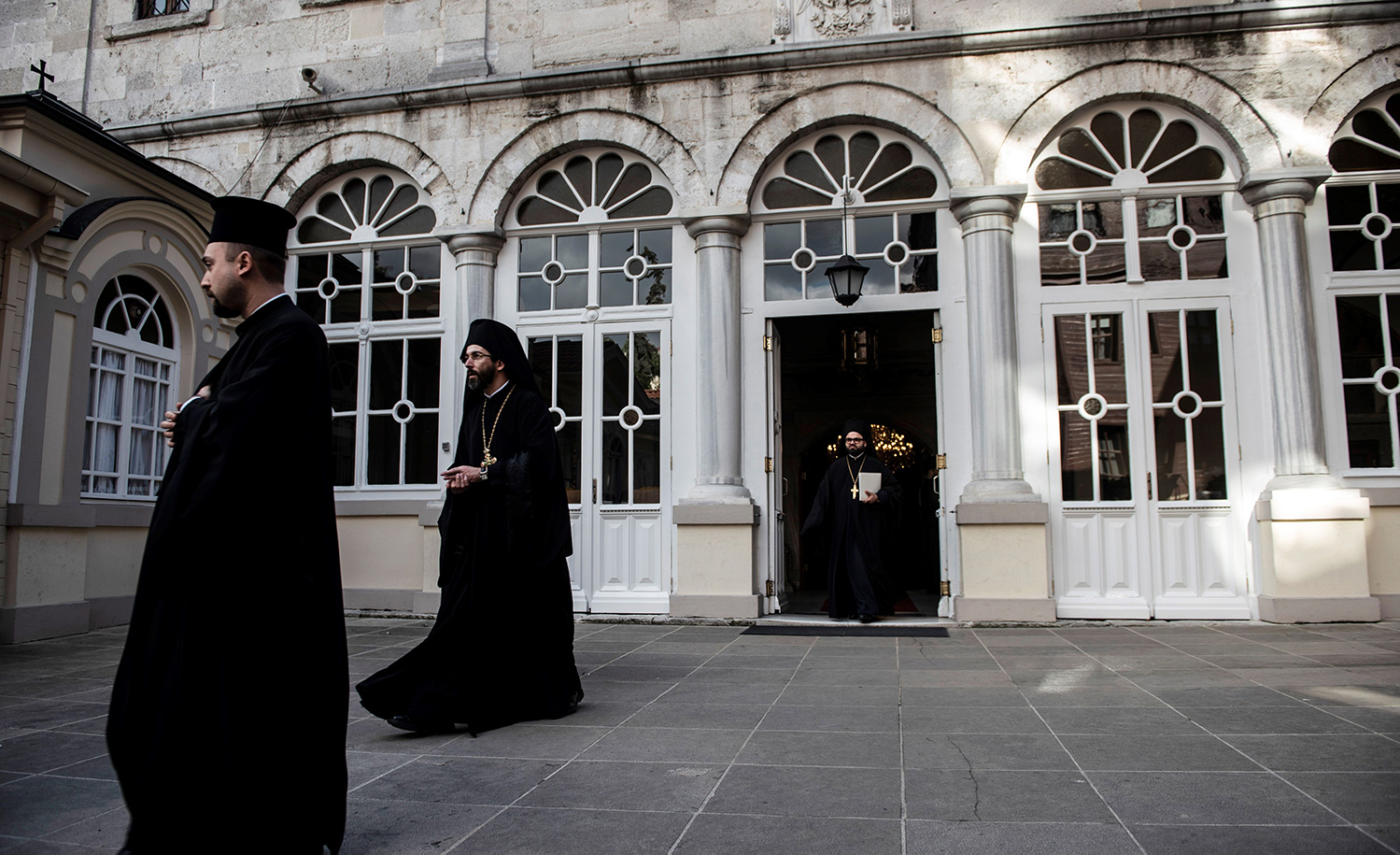 Orthodox officials walk outside the Fener Greek Patriarchate in Istanbul, Turkey on November 03, 2018. Getty.