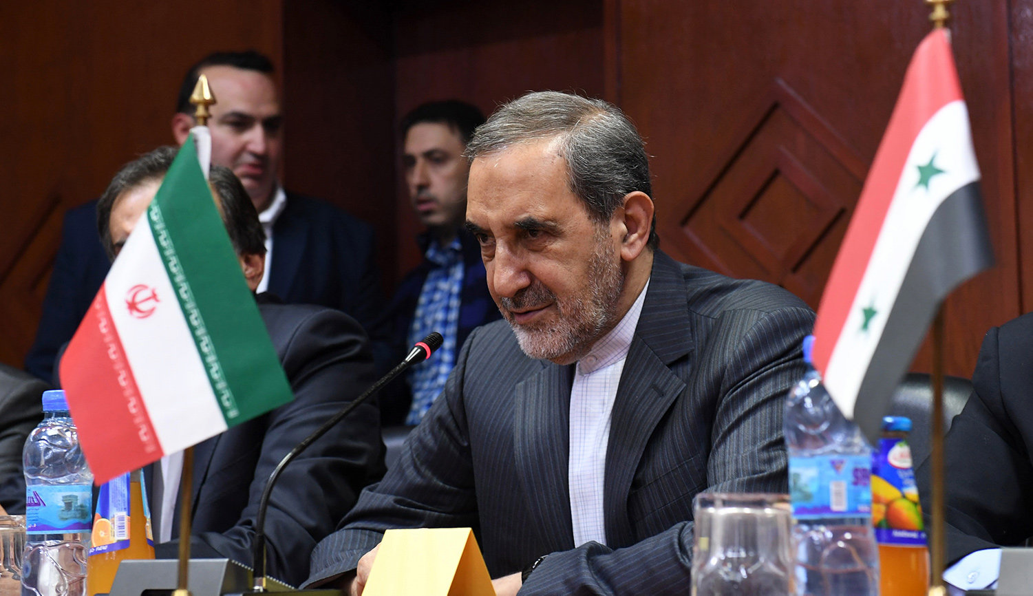 Ali Akbar Velayati (C), chief foreign policy advisor to Iran's supreme leader, on November 7, 2017, in Aleppo, Syria. GEORGE OURFALIAN/AFP/Getty Images.