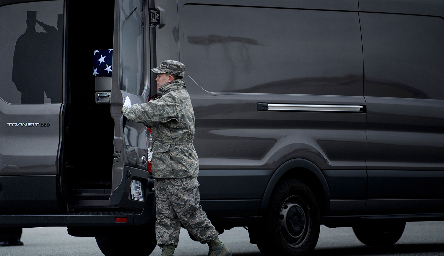 A member of the Air Force secures the remains of Scott A. Wirtz, a Defense Intelligence Agency civilian and former Navy Seal killed in a suicide bombing in Syria. BRENDAN SMIALOWSKI/AFP/Getty Images.