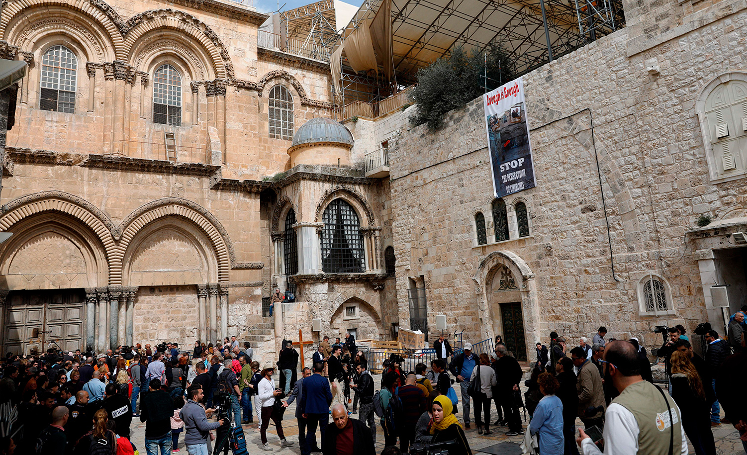 Journalists and pilgrims gather in the yard of the Church of the Holy Sepulchre in Jerusalem's Old City on February 25, 2018. GALI TIBBON/AFP/Getty Images.