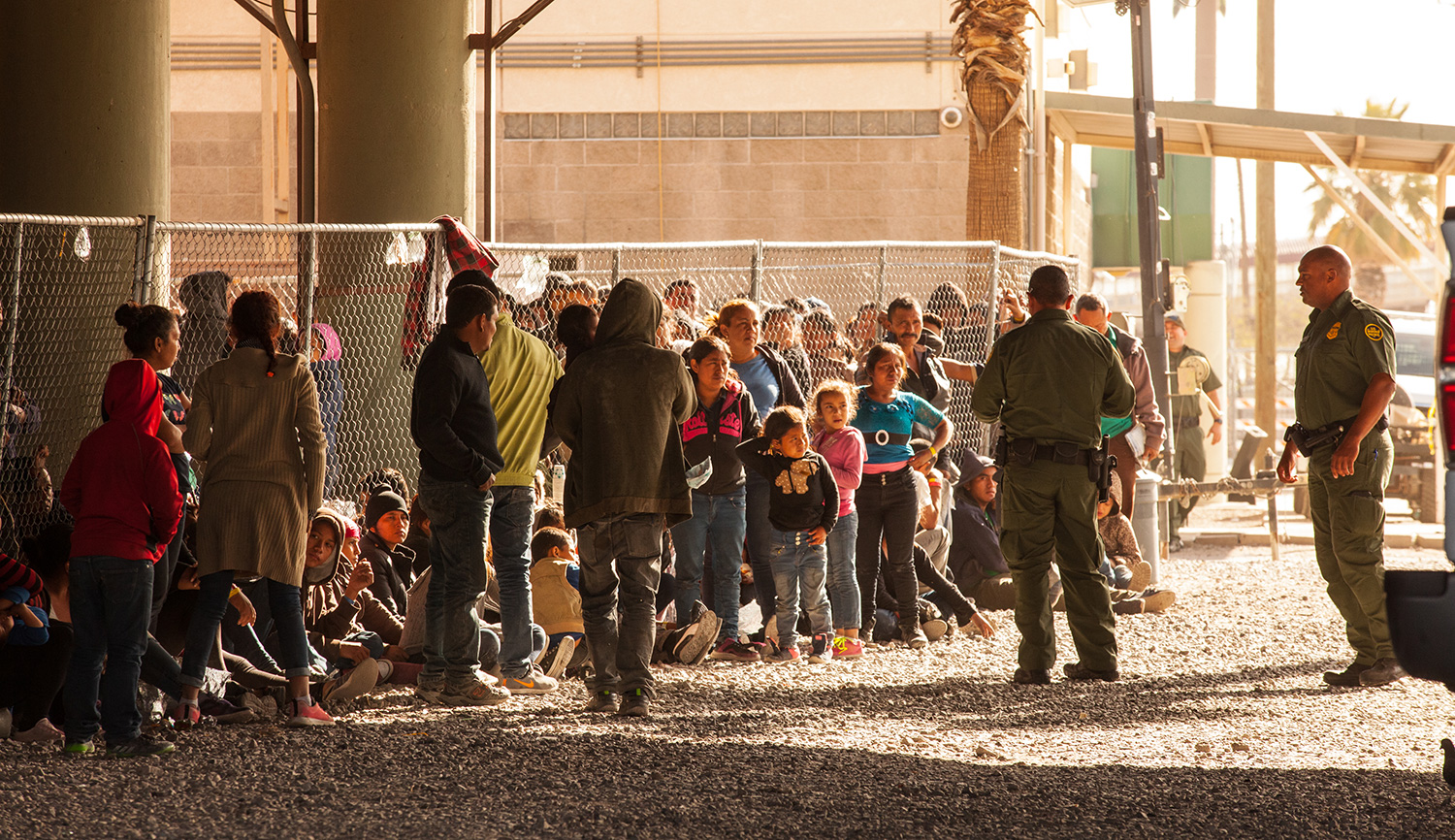 Migrants held in temporary fencing underneath the Paso Del Norte Bridge await processing on March 28, 2019 in El Paso, Texas. Christ Chavez/Getty Images.