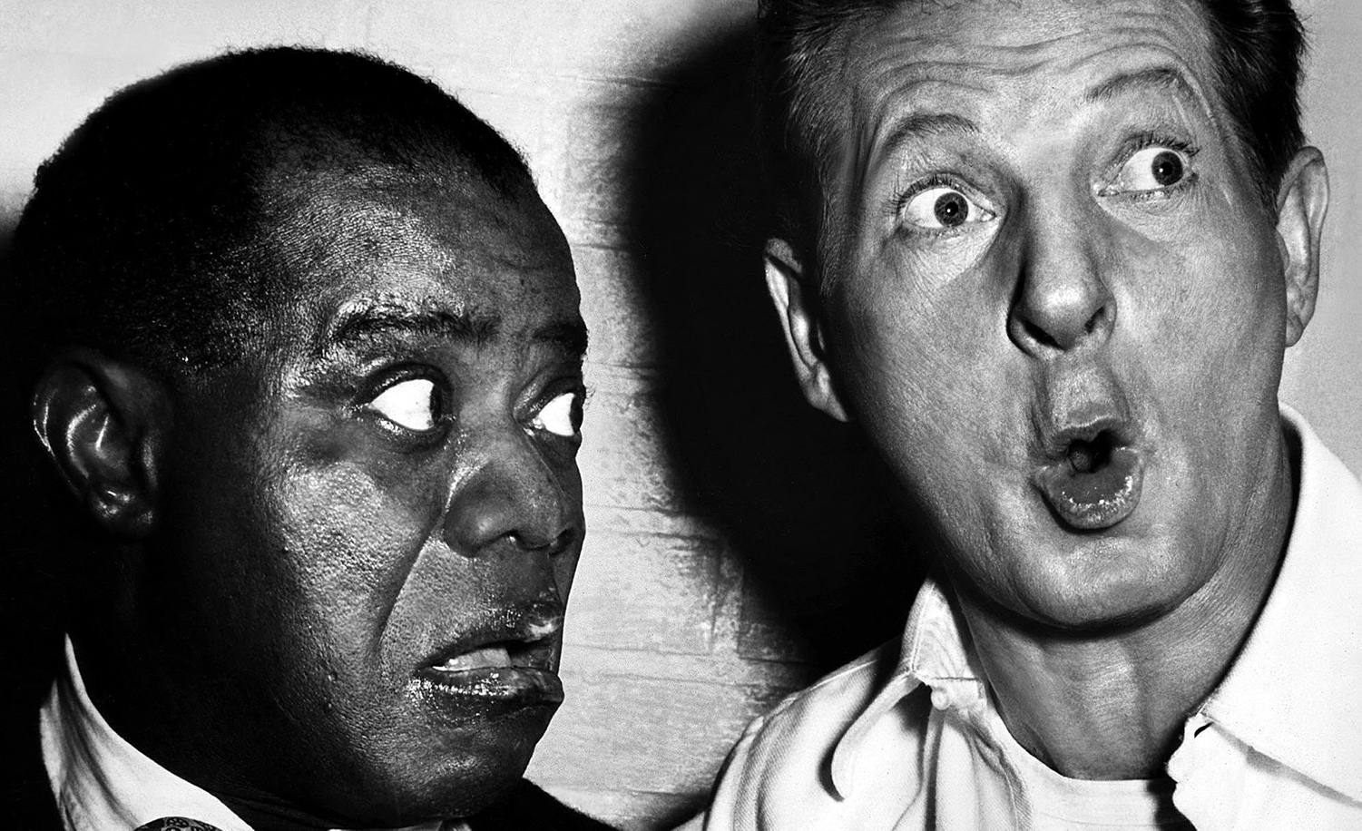 Louis Armstrong and Danny Kaye making a tararam in The Five Pennies, 1959. PARAMOUNT PICTURES and A.F. ARCHIVE.