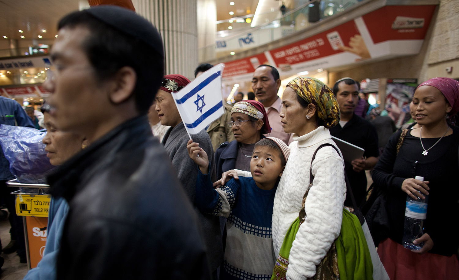 Members of the B'nei Menashe community reunite with relatives at Israel's Ben-Gurion airport on December 24, 2012. Uriel Sinai/Getty Images.
