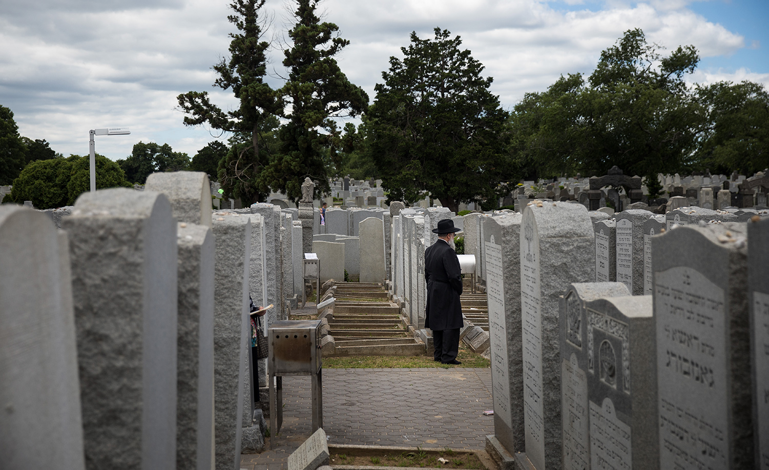 Visitors pray near the gravesite of Menachem Mendel Schneerson in Queens, New York. Drew Angerer/Getty Images.