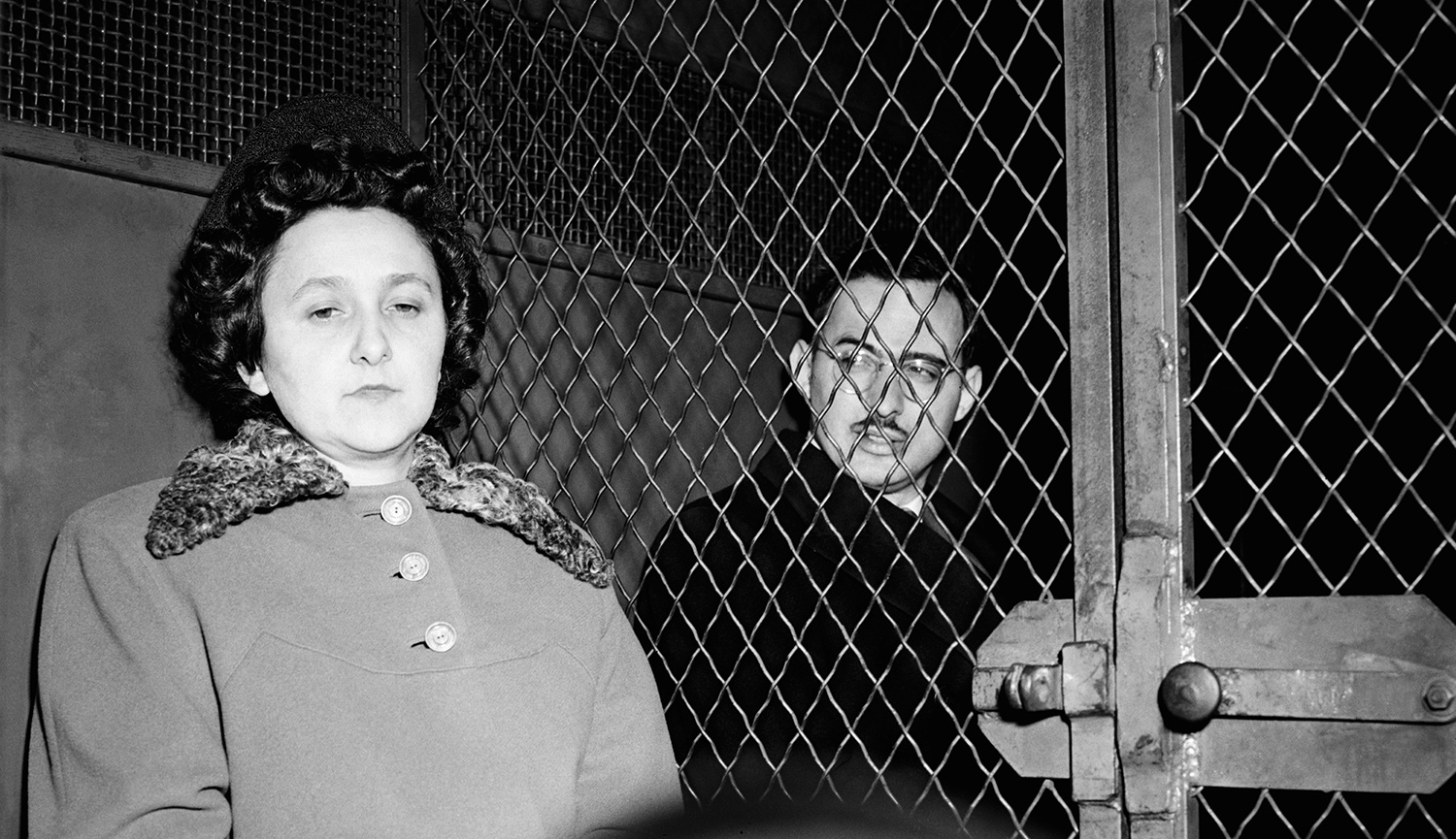 Ethel and Julius Rosenberg sitting in a police van after being convicted of espionage. Bettmann.