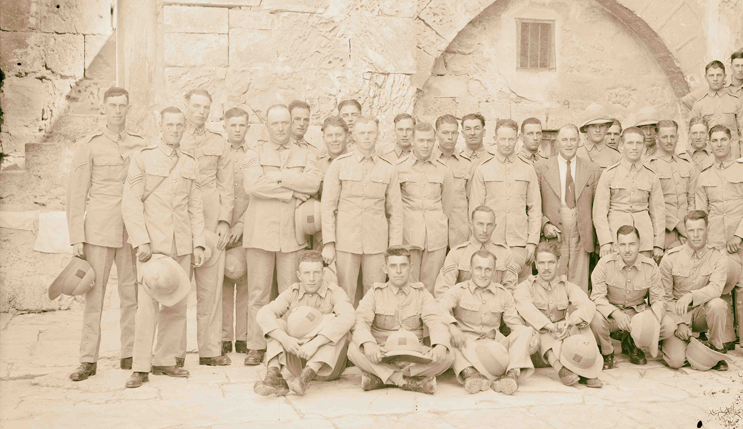 A group of British soldiers in the court of the Church of the Holy Sepulchre in 1917 in Jerusalem. Sepia Times/Universal Images Group via Getty Images.