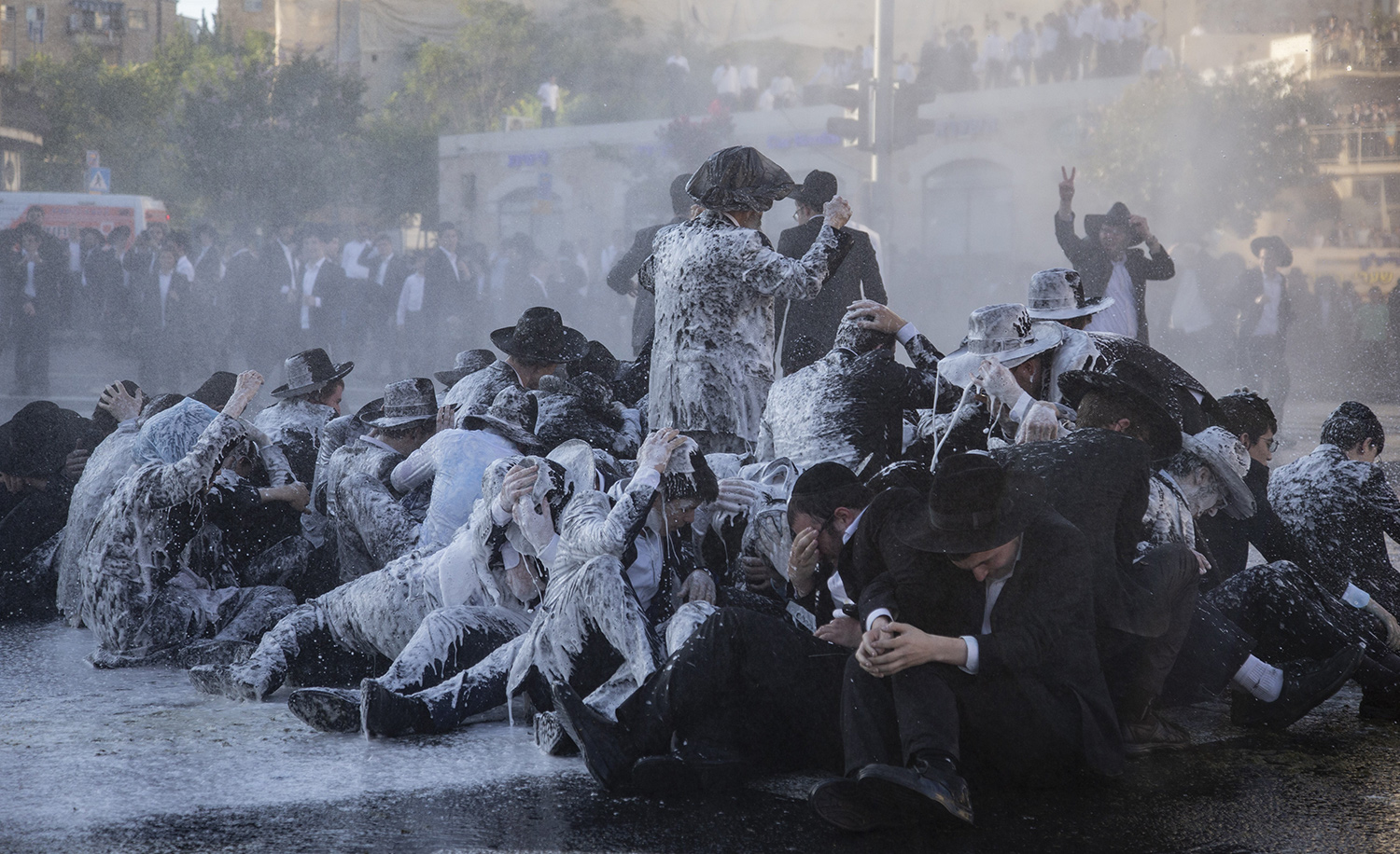 Israeli police officers turn water cannons on young ultra-Orthodox Jews gathered to protest their possible forced military conscription. Jerusalem, July 02, 2019. Faiz Abu Rmeleh/Anadolu Agency/Getty Images.